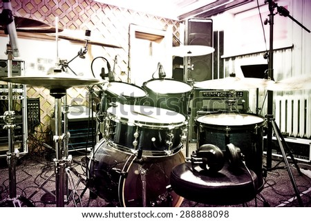 Drums conceptual image. Picture of drums in the recording studio. Retro vintage instagram picture. - stock photo