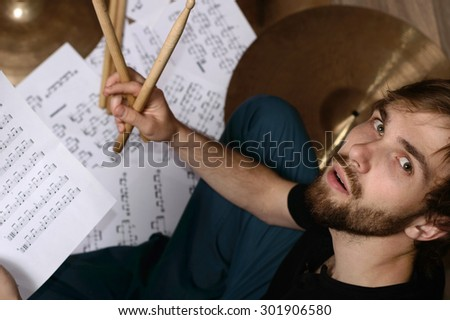 Drums conceptual image. Picture of man with stick and music notes. Background - cymbals, notes - stock photo