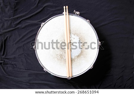 Drums conceptual image. Snare drum and stick over black background. - stock photo