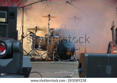 Drums musical tool on the stage in the smoke - stock photo