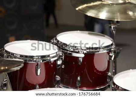 Drums on a Drumset with a cymbal and new drumheads  - stock photo