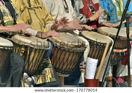 Drums player in group - stock photo