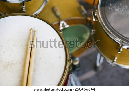 drums-set with sticks on snare-drums - stock photo