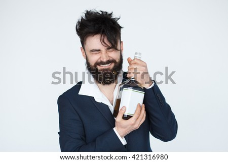 Drunk Bearded Man hugging a bottle of alcohold. Messy clothes and hairstyle after party isolated on white background