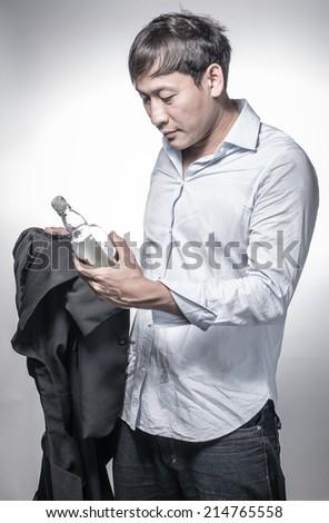 drunk business man  holding whiskey bottle - stock photo