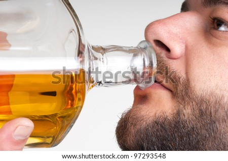 Drunk businessmen drinking from a bottle of whiskey - stock photo