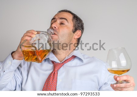 Drunk businessmen drinking whiskey - stock photo