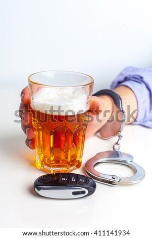 Drunk Driving Concept - Beer, Keys and Handcuffs - stock photo