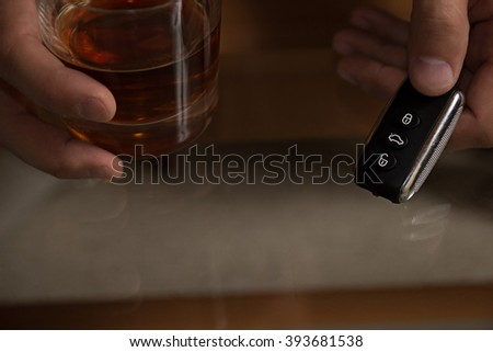 Drunk driving - the cause of car accidents. Drink driving. Male hands and keys. - stock photo