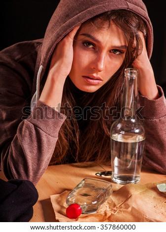 Drunk girl holding bottle of vodka. - stock photo
