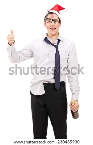 Drunk guy with Santa hat giving a thumb up isolated on white background - stock photo