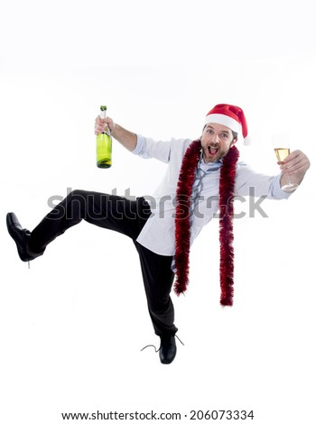 drunk happy attractive business man wearing santa hat with tinsel around neck in blue shirt and tie holding bottle and glass of champagne drinking and having fun at christmas party isolated on white - stock photo