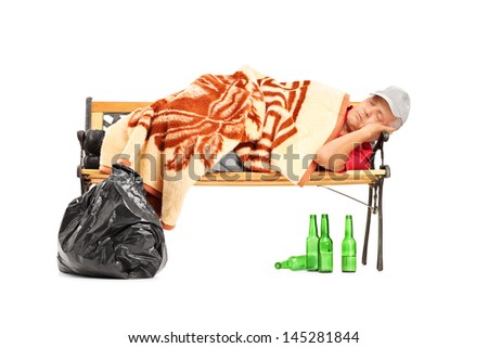 Drunk homeless man sleeping on a bench isolated on white background - stock photo