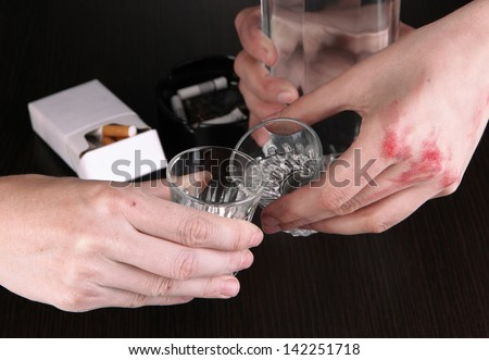 Drunk mans drinks vodka close-up