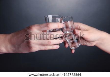 Drunk mans drinks vodka close-up - stock photo