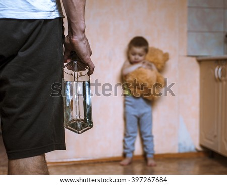 Drunk parent and little scared son with toy bear. Aggression in the family. - stock photo