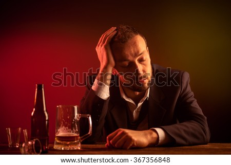 Drunk Sad Businessman Sleeping in a Bar