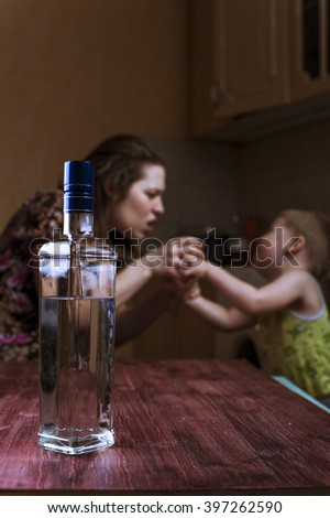 Drunk woman fights with her son. Family problems, alcohol abuse. Focus on bottle.