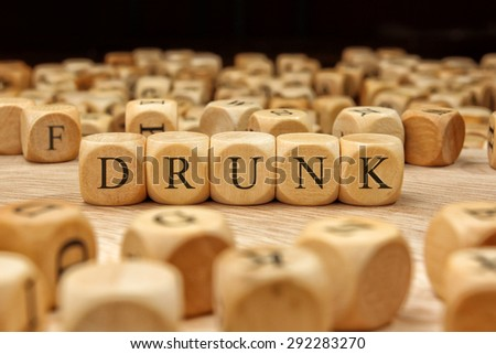 DRUNK word written on wood block - stock photo