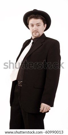 Drunkard in a black hat and a black suit - stock photo