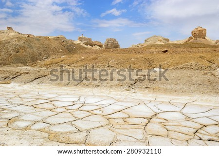 dry and cracked land with salt deposits in the desert near the Dead Sea, Israel - stock photo