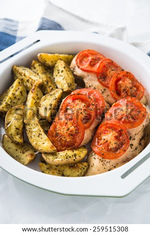 Dry basil parmesan fries and tomato chicken oven baked close up. - stock photo