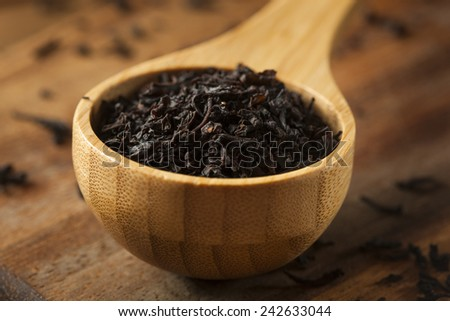 Dry Black Loose Leaf Tea in a Bowl - stock photo