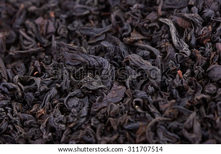 Dry Black Tea leaves close-up - stock photo