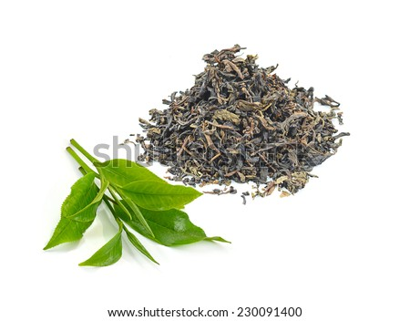 dry black tea leaves isolated on white - stock photo