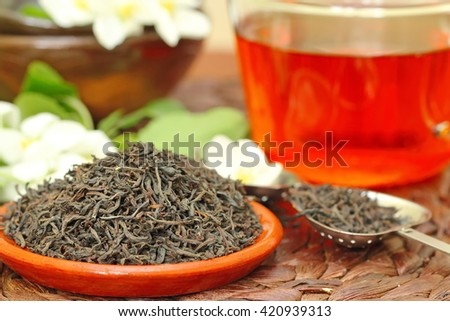 Dry black tea leaves with jasmine aroma