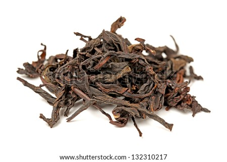 Dry black tea with green leaves, isolated on white