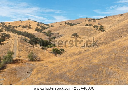 Dry brown hills along Pacheco Pass near Los Banos, California - stock photo