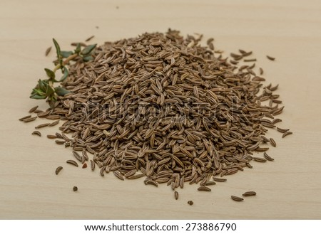 Dry caraway heap on the wood background - stock photo