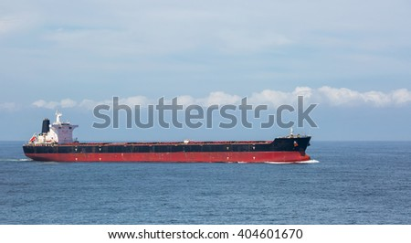 Dry cargo ship in the open ocean.