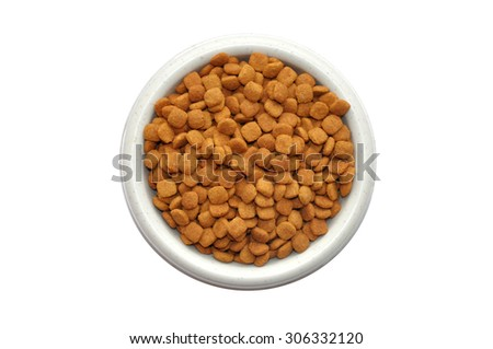 Dry cat food in plate isolated on white background - stock photo