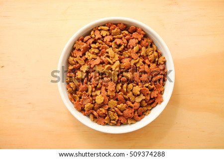Dry cat foods over wooden table background
