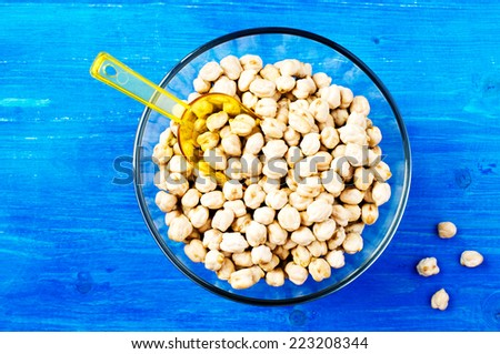 Dry chickpeas in a glass bowl. top view - stock photo