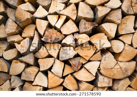 Dry chopped firewood logs ready for winter. Selective focus - stock photo