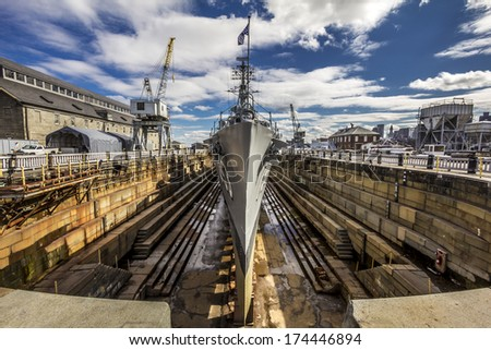 Dry doc in Charleston, Massachusetts, USA with the Second World War destroyer Cassin Young kept for repair and display for tourists. - stock photo