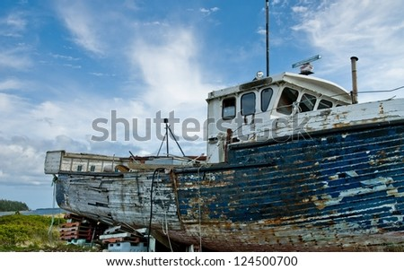 Dry docked fishing vessel[weathered] - stock photo