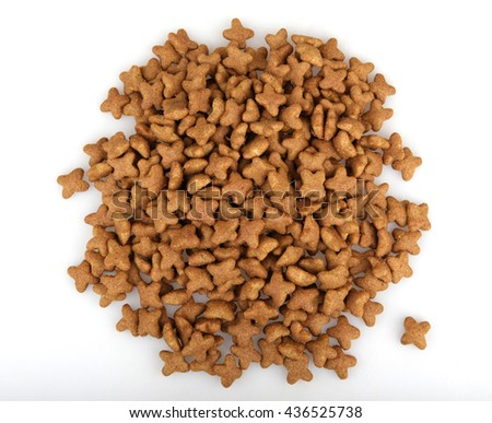 Dry dog food isolated on white background. - stock photo