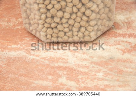 Dry Dog Food on wood, copy space - stock photo