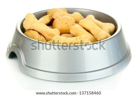 Dry dog treats in bowl isolated on white - stock photo