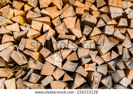 Dry firewood in a pile for furnace kindling, firewood texture - stock photo