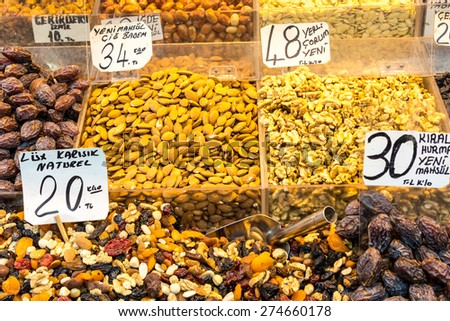 Dry fruits like mango, aple, apricot, ranberry, gojiberry, anise,nuts,seeds etc. on display in containers for sale in a bazaar, Turkey - stock photo