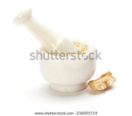 Dry ginger root grated in pestle and mortar isolated on white background - stock photo