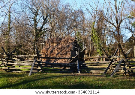 Dry grass roof shelter in a park in Williamsburg colonial town in Virginia, United States of America - stock photo
