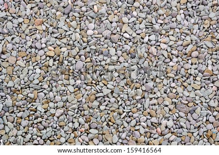 Dry gray textured sea stone pebble gravel background - stock photo