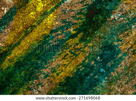 Dry ground surface colored green in closeup - stock photo