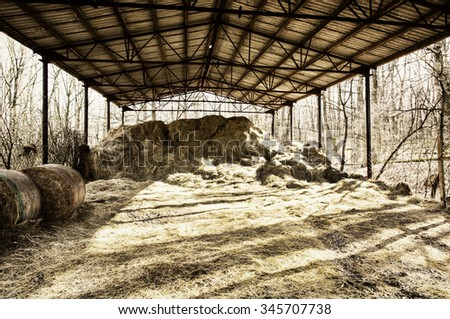 Dry hay under the roof. Rural scene. Farmhouse in the country. - stock photo